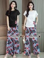 ชุดเซทแฟชั่น เซตเสื้อ+กางเกง ตัวเสื้อทรงปล่อยสีพื้นเก๋ที่มีผ้าลายเดียวกับกางเกงผูกโบว์ข้าง