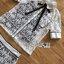 ชุดเซทแฟชั่น เซ็ตเสื้อเชิ้ตและกางเกงผ้าลูกไม้สีขาวตกแต่งริบบิ้นสีดำ thumbnail 12