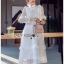 Lady Christine Ruffle Layered White Lace Dress เดรสผ้าลูกไม้สีขาวตกแต่งระบายและเลเยอร์ ลุคนี้ใส่ไปงานแต่งงานได้เลยค่ะ เด่นสุดๆ ทรงคอเสื้อตกแต่งลูกไม้เป็นทรงคอสูง ช่วงตัวเดรสเล่นกับลายลูกไม้ตัดต่อสลับเป็นระบายทั้งที่หน้าอก และแขนเสื้อ ช่วงกระโปรงตกแต่งระบา thumbnail 2
